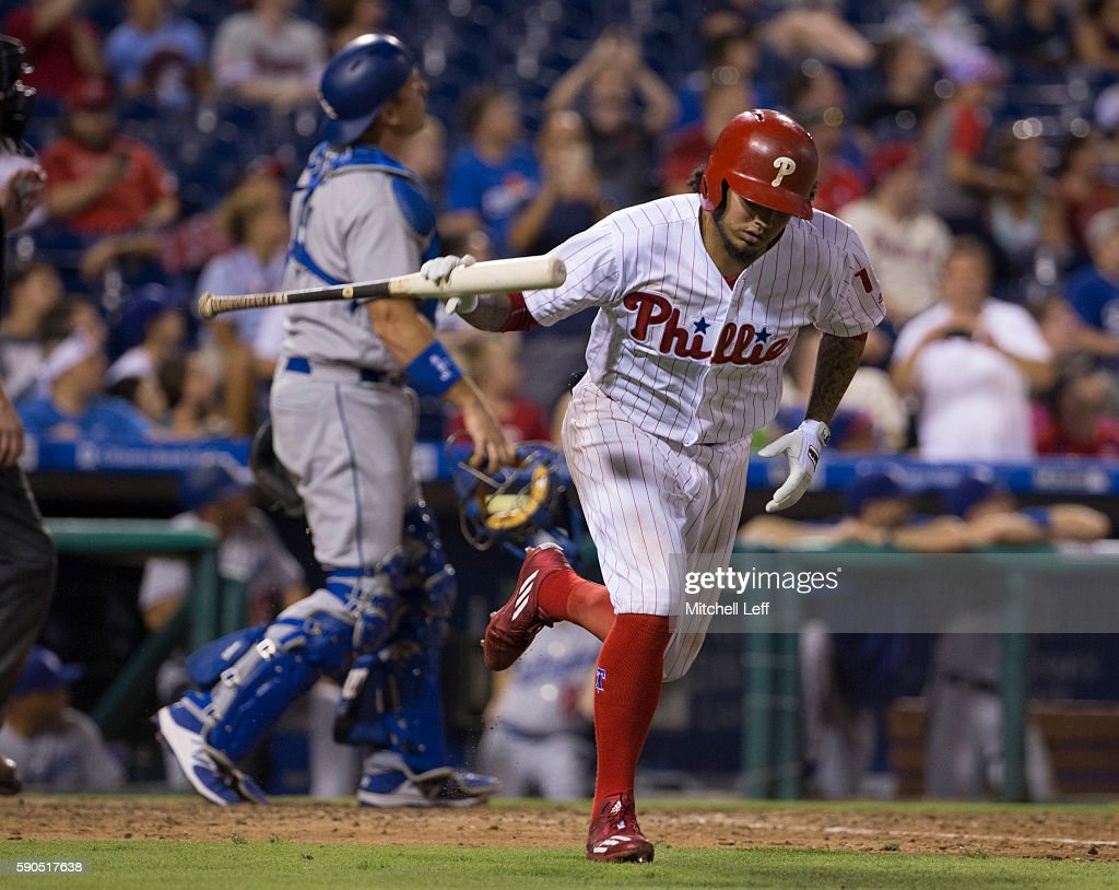 Freddy Galvis #13 of the Philadelphia Phillies slams his bat after popping out in the bottom of the seventh inning against the Los Angeles Dodgers at Citizens Bank Park on August 16, 2016 in Philadelphia, Pennsylvania. The Dodgers defeated the Phillies 15-5.
