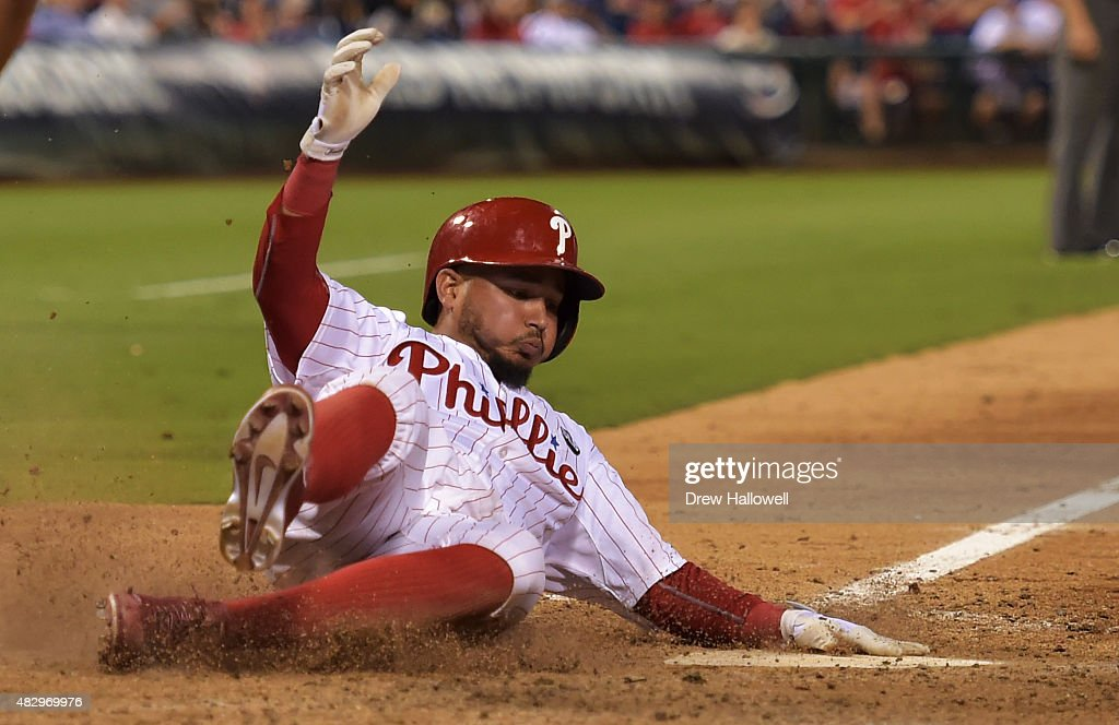 Freddy Galvis #13 of the Philadelphia Phillies slides in for a run in the eighth inning against the Los Angeles Dodgers at Citizens Bank Park on August 4, 2015 in Philadelphia, Pennsylvania.