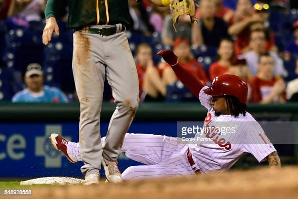 Freddy Galvis of the Philadelphia Phillies slides safely into third base during the fifth inning at Citizens Bank Park on September 16 2017 in...