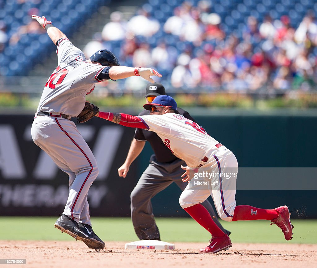 Freddy Galvis #13 of the Philadelphia Phillies tags out Ryan Lavarnway #30 of the Atlanta Braves after Lavarnway tried to stretch a single into a double in the top of the fifth inning on August 2, 2015 at the Citizens Bank Park in Philadelphia, Pennsylvania. The Braves defeated the Phillies 6-2.