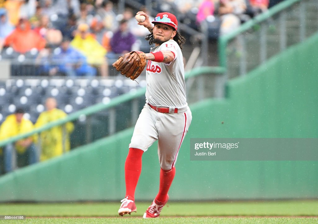 Freddy Galvis #13 of the Philadelphia Phillies throws to first base for a force out in the fifth inning during the game against the Pittsburgh Pirates at PNC Park on May 21, 2017 in Pittsburgh, Pennsylvania.