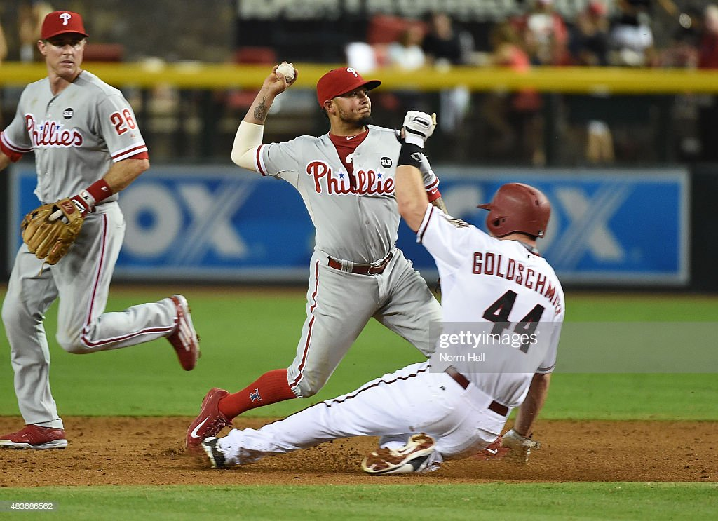 Freddy Galvis #13 of the Philadelphia Phillies turns a double play over the top of a sliding Paul Goldschmidt #44 of the Arizona Diamondbacks during the third inning at Chase Field on August 11, 2015 in Phoenix, Arizona.