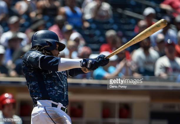 Freddy Galvis of the San Diego Padres hits a grand slam during the third inning of a baseball game against the Philadelphia Phillies at PETCO Park on...