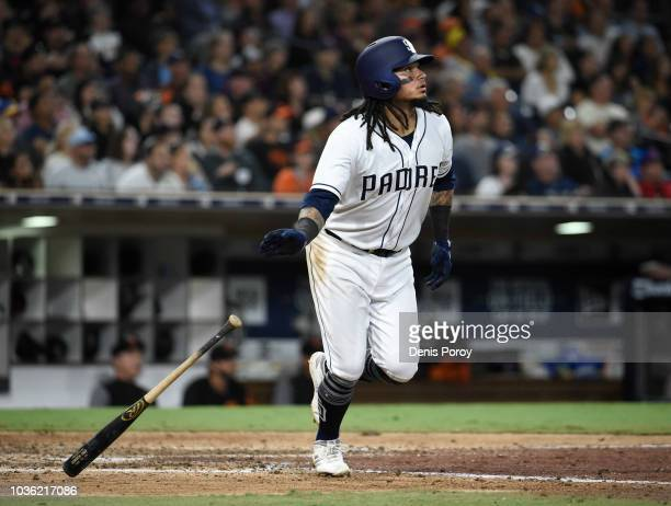 Freddy Galvis of the San Diego Padres hits a threerun home run during the eighth inning of a baseball game against the San Francisco Giants at PETCO...