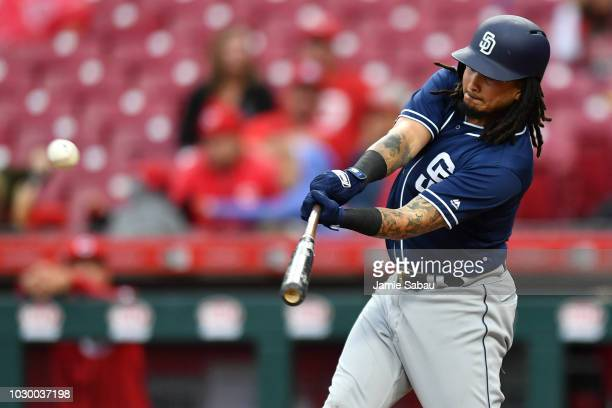 Freddy Galvis of the San Diego Padres hits a tworun double in the fifth inning against the Cincinnati Reds at Great American Ball Park on September 9...