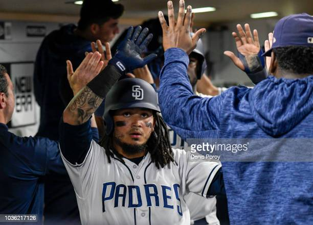 Freddy Galvis of the San Diego Padres is congratulated after hitting a threerun home run during the eighth inning of a baseball game against the San...