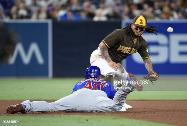 Freddy Galvis of the San Diego Padres loses the ball as Willson Contreras of the Chicago Cubs slides into second base during the fourth inning of a...