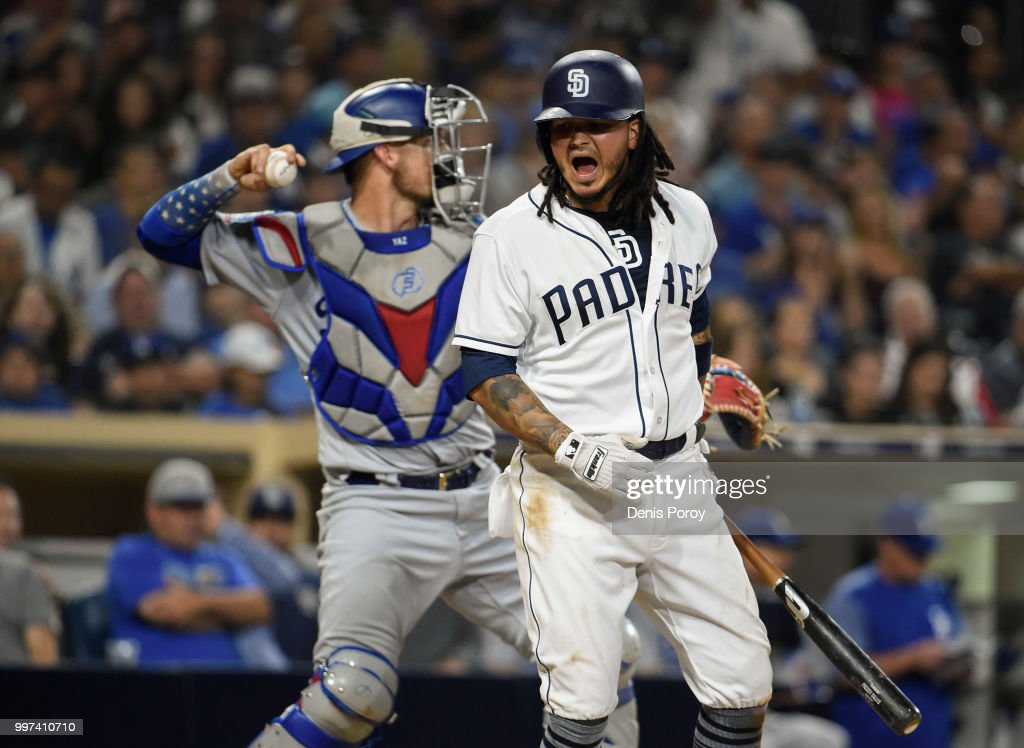 Freddy Galvis #13 of the San Diego Padres reacts after striking out during the eighth inning of a baseball game against the Los Angeles Dodgers at PETCO Park on July 12, 2018 in San Diego, California.