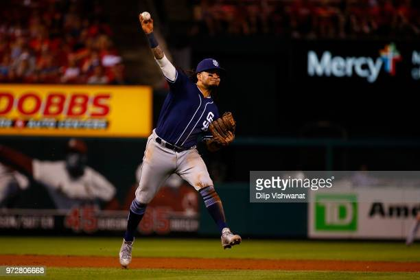 Freddy Galvis of the San Diego Padres throws to first base against the St Louis Cardinals in the eighth inning at Busch Stadium on June 12 2018 in St...