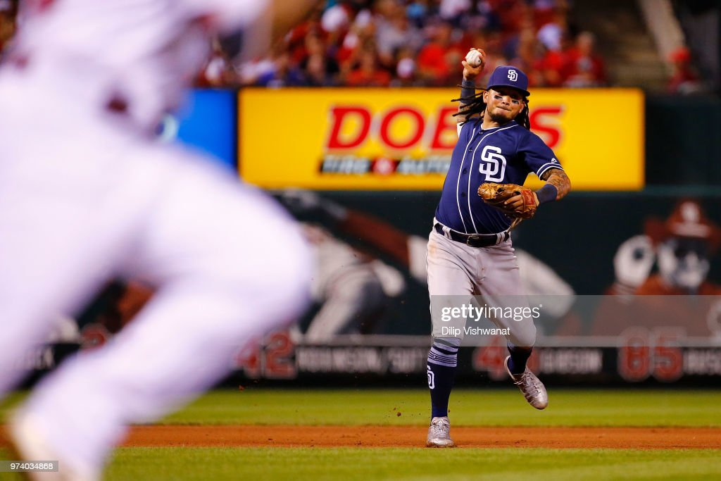 Freddy Galvis #13 of the San Diego Padres throws to first base against the St. Louis Cardinals in the fifth inning at Busch Stadium on June 13, 2018 in St. Louis, Missouri.
