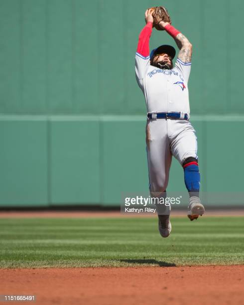Freddy Galvis of the Toronto Blue Jays makes a leaping catch in the first inning against the Boston Red Sox at Fenway Park on June 23 2019 in Boston...