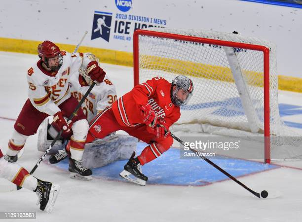 Freddy Gerard of the Ohio State Buckeyes receives a pass in front of the goal against Ian Mitchell and Filip Larsson of the Denver Pioneers during an...