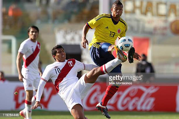 Freddy Guarín from Colombia fights for the ball with Rinaldo Cruzado from Peru During a quarter final match between Colombia and Peru at Mario...