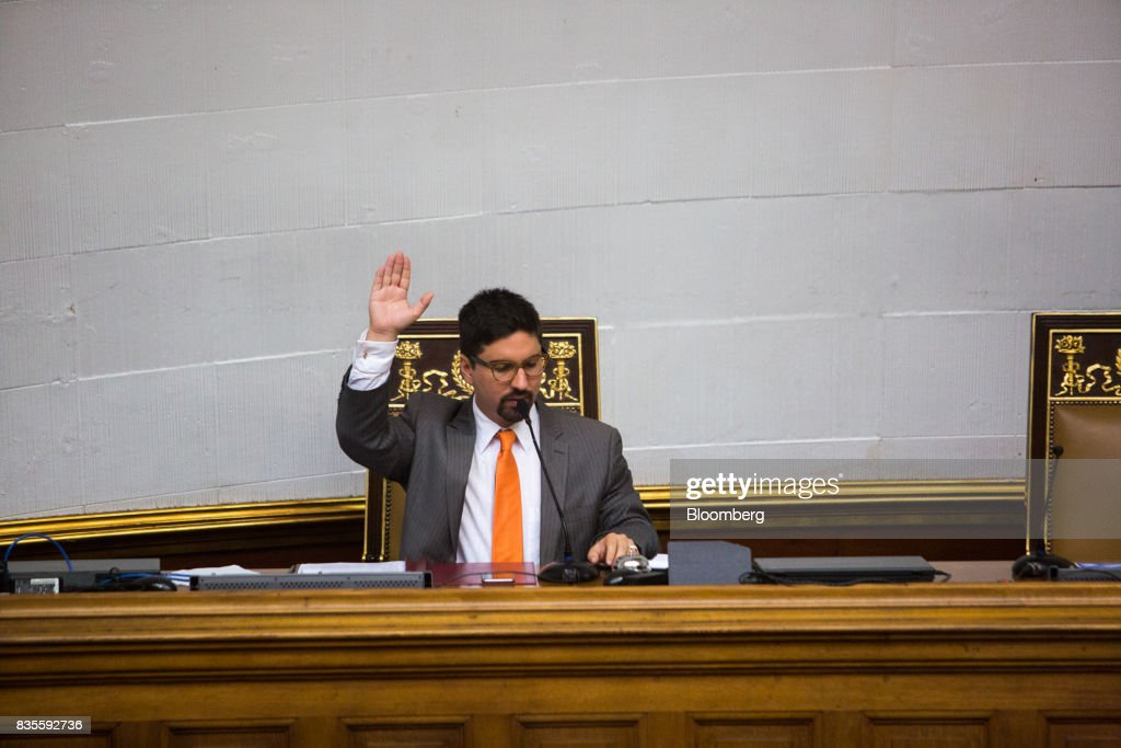 Freddy Guevara, vice president of the National Assembly, speaks while raising his right hand during a special session of the National Assembly of Caracas, Venezuela, on Saturday, Aug. 19, 2017. Venezuela's new legislative super body took over the functions of the country's only remaining opposition-run institution -- the National Assembly -- by approving a decree that empowers it to pass laws on a range of issues. Photographer: Wil Riera/Bloomberg via Getty Images