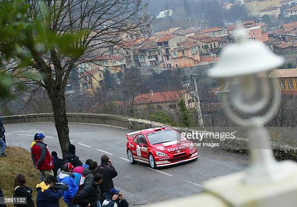 Freddy Loix of Belgium drives his Peugeot 307 WRC during the shake down for the Monte Carlo Rally January 22 2004 in Monaco
