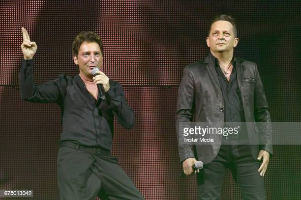 Freddy Maerz and Martin Marcell of the band Fantasy perform during 'Die Schlagernacht des Jahres' at Lanxess Arena on April 29 2017 in Cologne Germany
