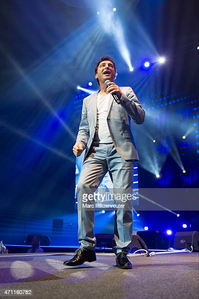 Freddy Maerz of SchlagerDuo 'Fantasy' performs on stage during the 'Schlagernacht des Jahres' at the Lanxess Arena on April 25 2015 in Cologne Germany