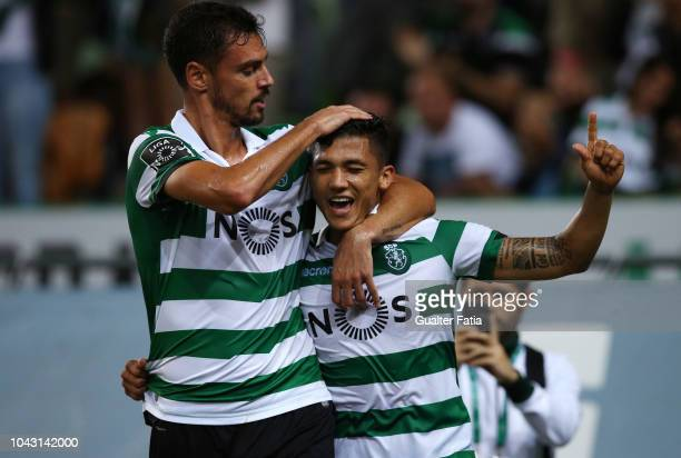 Freddy Montero of Sporting CP celebrates with teammate Andre Pinto of Sporting CP after scoring a goal during the Liga NOS match between Sporting CP...