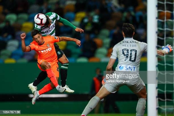 Freddy Montero of Sporting CP vies with Edu Machado of Boavista FC for the ball possession during the Liga NOS round 8 match between Sporting CP and...