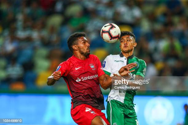 Freddy Montero of Sporting CP vies with Lucas Africo of CS Maritimo for the ball possession during the Portuguese League Cup match between Sporting...