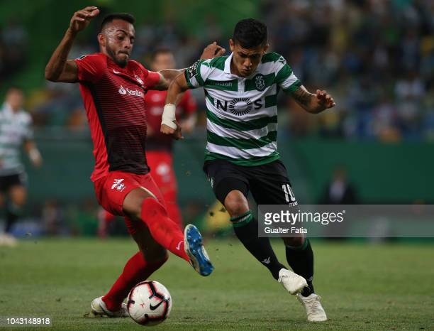 Freddy Montero of Sporting CP with Marcao of CS Maritimo in action during the Liga NOS match between Sporting CP and CS Maritimo at Estadio Jose...