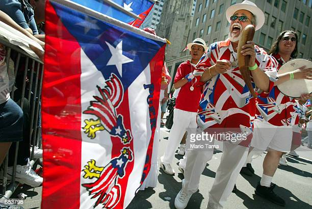 Freddy Nelez and other members of the Orgullo Caino band during the Puerto Rican Day Parade June 9 2002 in New York City The Puerto Rican Day Parade...