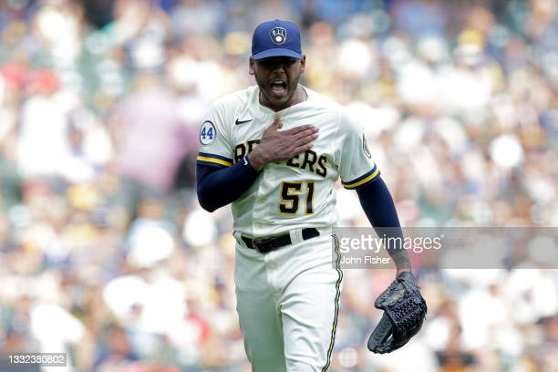 Freddy Peralta of the Milwaukee Brewers pounds his chest after getting out of a jam in the sixth inning against the Pittsburgh Pirates at American...