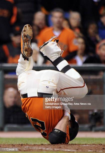 Freddy Sanchez gets hit by a Billy Wagner pitch in the 10th inning of Game 2 of the National League Division Series between the San Francisco Giants...