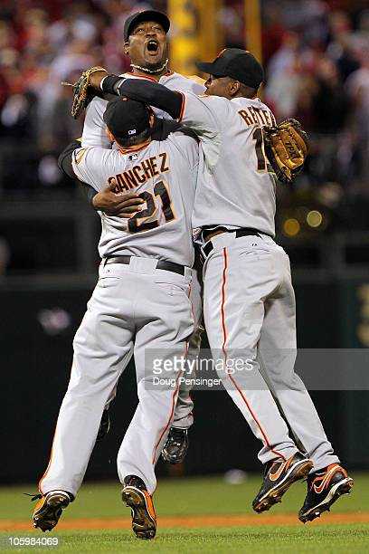 Freddy Sanchez Juan Uribe and Edgar Renteria of the San Francisco Giants celebrate defeating the Philadelphia Phillies 32 and winning the pennant in...
