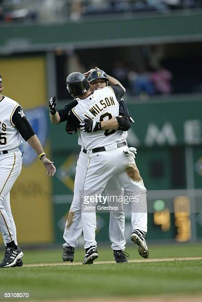 Freddy Sanchez of the Pittsburgh Pirates is greeted by teammate Jack Wilson after the game against the Florida Marlins at PNC Park on May 30 2005 in...