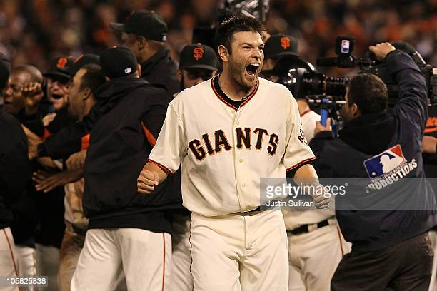 Freddy Sanchez of the San Francisco Giants celebrates after a sacrifice fly by Juan Uribe scored Aubrey Huff to win the game 6-5 over the...