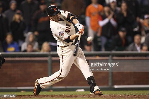 Freddy Sanchez of the San Francisco Giants connects with the winning hit in the 13th inning against the Washington Nationals during an MLB game at...