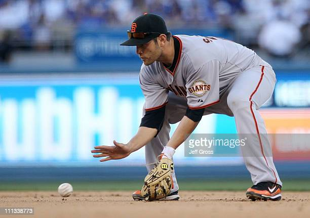 Freddy Sanchez of the San Francisco Giants fields a ground ball against the Los Angeles Dodgers on Opening Day at Dodger Stadium on March 31 2011 in...