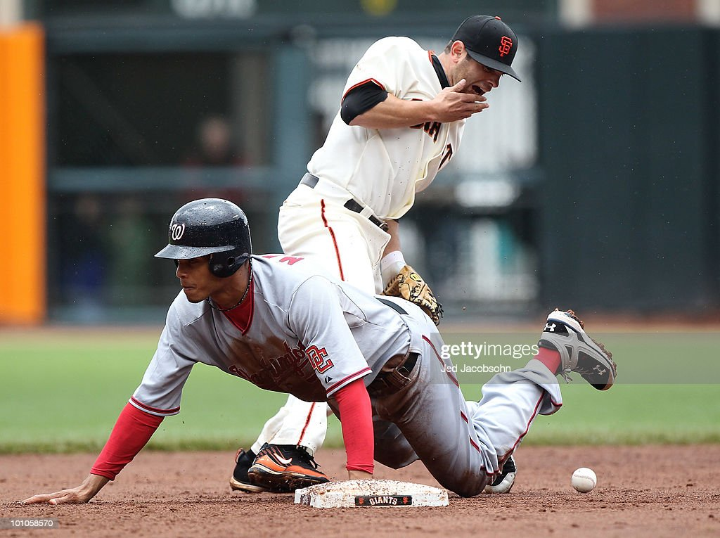 Freddy Sanchez #21 of the San Francisco Giants is kicked in the face on a steal by Justin Maxwell #30 of the Washington Nationals during an MLB game at AT&T Park on May 27, 2010 in San Francisco, California.
