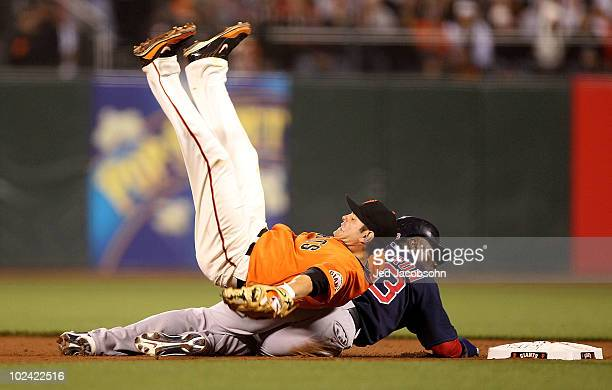 Freddy Sanchez of the San Francisco Giants is knocked over by Mike Cameron of the Boston Red Sox on a fielders choice hit by Kevin Youkilis in the...