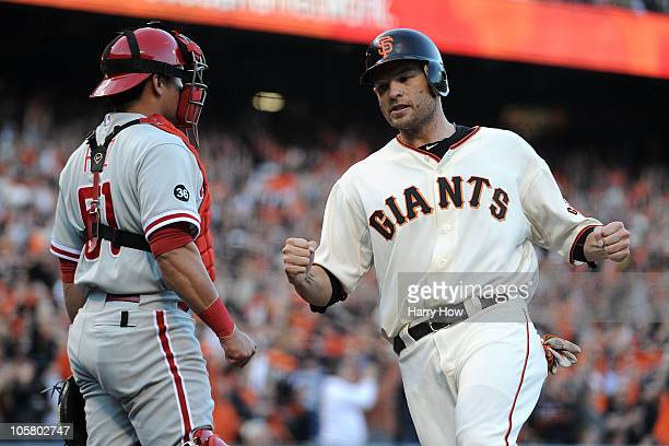 Freddy Sanchez of the San Francisco Giants reacts after scoring on an RBI single by Buster Posey in the first inning of Game Four of the NLCS during...