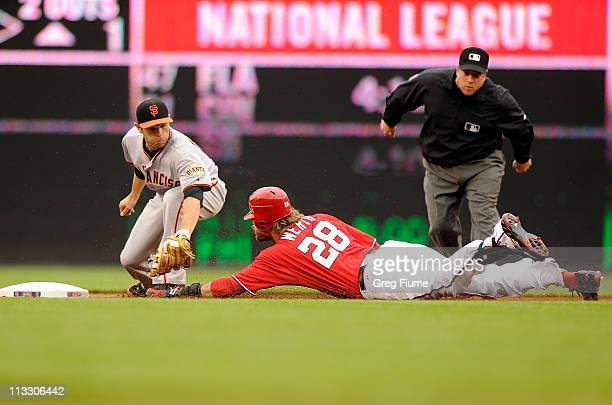 Freddy Sanchez of the San Francisco Giants tags out Jayson Werth of the Washington Nationals at second base in the first inning at Nationals Park on...