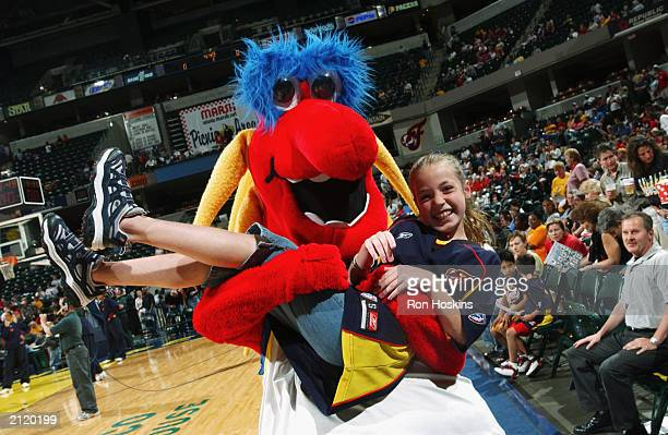 Freddy the Indiana Fever mascot and a young fan have some fun during the WNBA game between the Connecticut Sun and the Indiana Fever at Conseco...