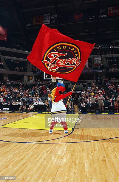 Freddy waves an Indiana Fever flag during the WNBA game against the Detroit Shock at Conseco Fieldhouse on July 6 2003 in Indianapolis Indiana The...
