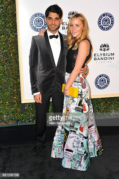 Freddy Wexler and Olivia Zaro attend Stevie Wonder's HEAVEN 10th Anniversary celebration presented by The Art of Elysium at Red Studios on January 7...