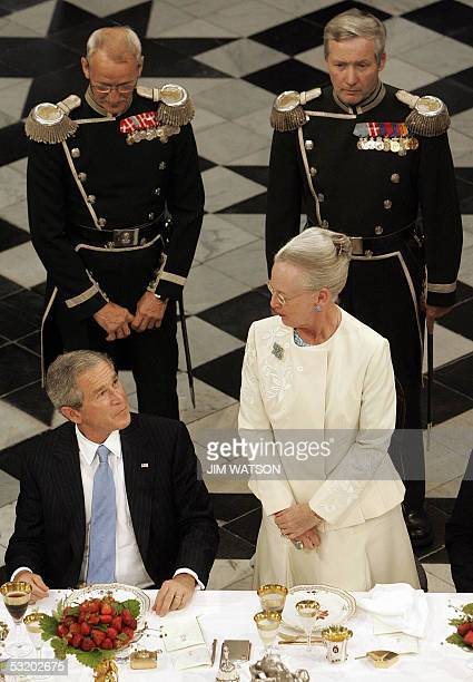 President George W. Bush listens to Queen Margrethe II of Denmark deliver a speech 06 July 2005 during a reception at Fredensborg Palace in...
