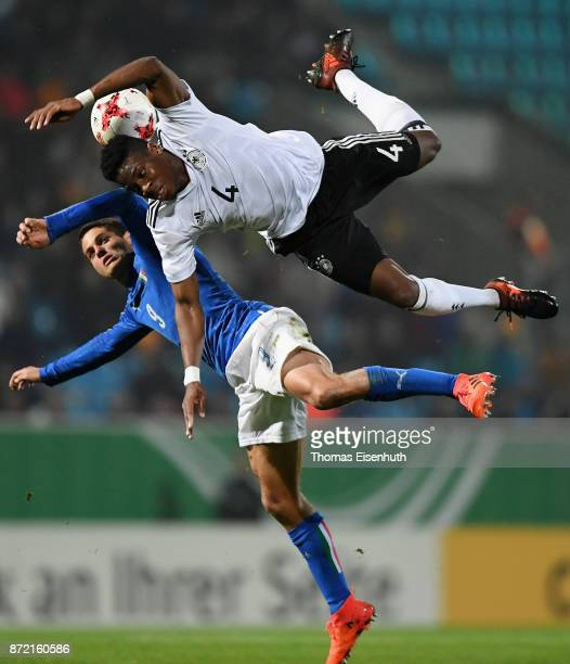 Frederic Ananou of Germany and Alessandro Rossi of Italy vie for the ball during the Under 20 International Friendly match between U20 of Germany and...