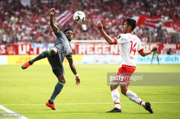 Frederic Ananou of Ingolstadt 04 is challenged by Marcel Correia of Jahn Regensburg during the Second Bundesliga match between SSV Jahn Regensburg...