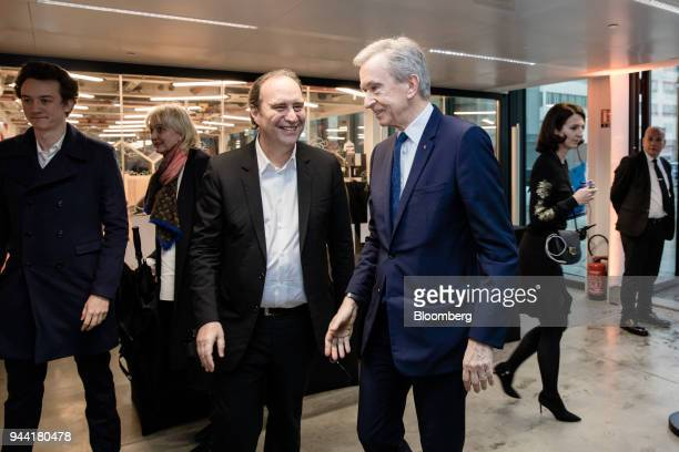 Frederic Arnault head of connected technologies at Tag Heuer International SA left Xavier Niel billionaire and deputy chairman of Iliad SA center and...