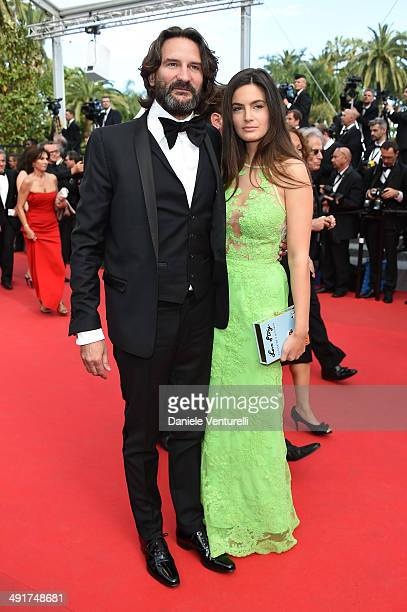 Frederic Beigbeder and Lara Micheli attend the 'Saint Laurent' Premiere at the 67th Annual Cannes Film Festival on May 17 2014 in Cannes France