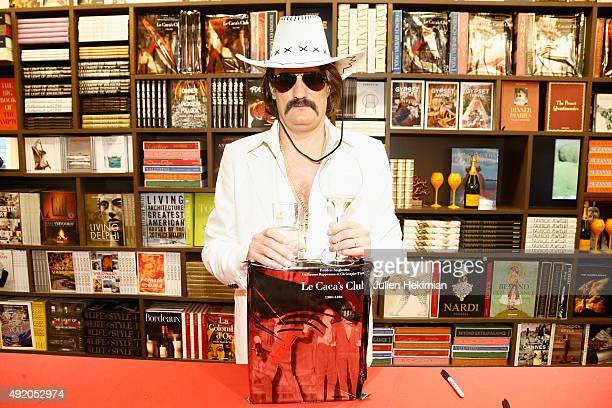 Frederic Beigbeder poses with his new book Le Caca's Club at Librairie Assouline on October 9 2015 in Paris France
