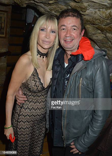 Frederic Bouraly from 'Scene de Menage' and 2 Mains Rouges president Patricia attend the 'Les 10 Ans de Marc Mitonne' Party Hosted by '2 Mains...