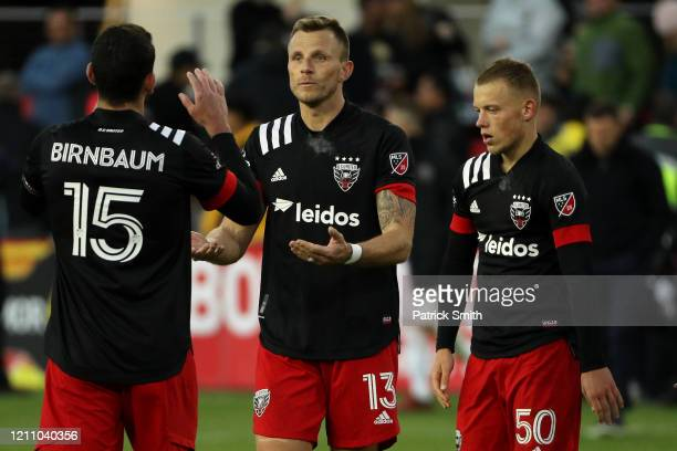 Frederic Brillant of DC United celebrates with teammates after defeating Inter Miami during the second half at Audi Field on March 7 2020 in...