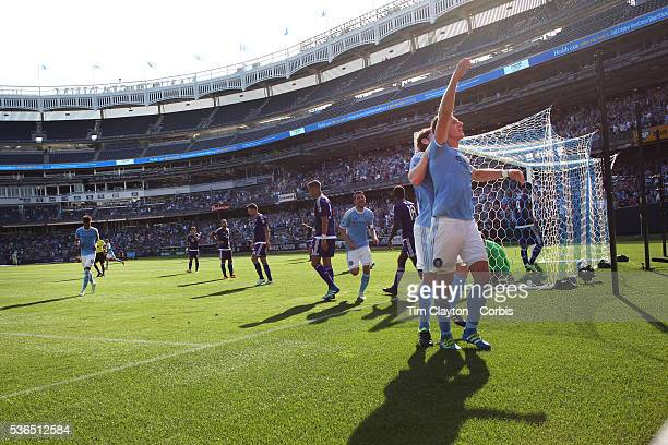 Frederic Brillant of New York City FC celebrates after heading his side first goal past goalkeeper Joseph Bendik of Orlando City FC during the New...