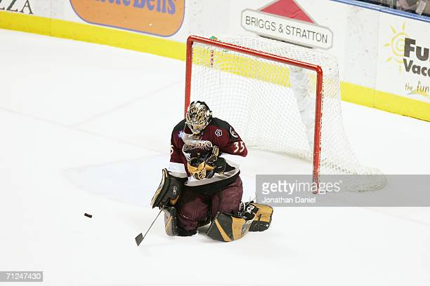 Frederic Cassivi of the Hershey Bears makes a save against the Milwaukee Admirals in game six of the Calder Cup Finals on June 15, 2006 at the...